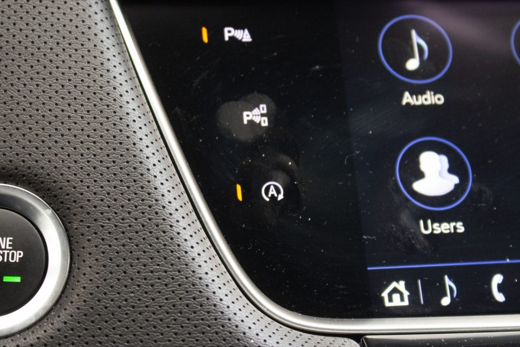 Engine auto stop-start disable button (last in the vertical row) in the 2020 Cadillac XT5