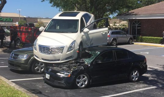 Cadillac XTS Reverses Through Intersections, Lands On Parked Cars: Video